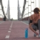 Senior Sporty Female Ties Shoelaces on Bridge - VideoHive Item for Sale