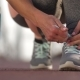 Female Tying Shoelaces and Taking Water - VideoHive Item for Sale