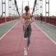 Back View of Female Stretching Legs and Running - VideoHive Item for Sale