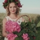 Portrait of a Girl with a Wreath and a Basket of Flowers in the Field - VideoHive Item for Sale