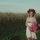 Beautiful Girl with a Basket of Flowers Walks in the Field - VideoHive Item for Sale