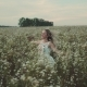 Young Woman in Dress Running Through White Field Touching Flowers - VideoHive Item for Sale