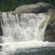 Beautiful Waterfall Flowing on Large Stones in Mountain River. Flow Mountain River in Waterfall - VideoHive Item for Sale