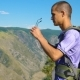 A Tourist with a Backpack in the Mountains. - VideoHive Item for Sale