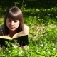 Beautiful Girl Reading a Book in Forest on Flowers Field - VideoHive Item for Sale
