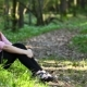Beautiful Girl Sitting Near the Trail in the Woods - VideoHive Item for Sale