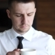Young Man in a White Shirt Drinking Coffee, - VideoHive Item for Sale