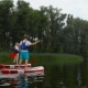 Couple Is Floating on Kayaks Along the River - VideoHive Item for Sale