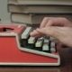 Man's Hands Typing on a Red Typewriter - VideoHive Item for Sale