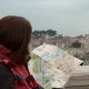 Attractive Woman Tourist Looking at Map Near Castel Sant Angelo and Vatican City - VideoHive Item for Sale