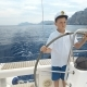 Litle Children Captain at the Helm Controls of a Sailing Yacht During Race - VideoHive Item for Sale