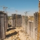 Construction of Houses. Drone Fly Over Construction Site with Tower Cranes - VideoHive Item for Sale