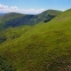 Aerial of a Curvy Lane and a Lengthy Green Range in the Carpathians in Summer - VideoHive Item for Sale
