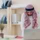 Modern Middle Eastern Man in Ethnic Costume Working in the Office at the Desk. Businessman with - VideoHive Item for Sale