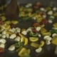 Chef Cooking Garlic and Peppers While Preparing Food in Restaurant Kitchen - VideoHive Item for Sale