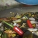 Chef Cook Cooking Spanish Paella with Red Hot Peppers and Fresh Seafood in Pan . Preparation - VideoHive Item for Sale