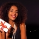 African - American Young Woman in Party Dress Holding Gift Box  - VideoHive Item for Sale
