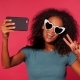 Smiling Happy African American Woman with Curly Hair in Green T-shirt Making Selfie on Smartphone - VideoHive Item for Sale