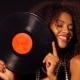 African-american Young Woman in Party Dress Holding Vinyl Record and Dancing on Black Lights - VideoHive Item for Sale