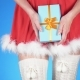 Christmas Holidays. Young Attractive Woman in a Snow Maiden Costume with a Gift, Dancing on a Blue - VideoHive Item for Sale