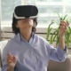 Mature Woman Testing Virtual Reality Glasses - VideoHive Item for Sale