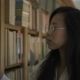 Beautiful Asian Biologist Student Is Walking Along Bookshelves in Library Indoors - VideoHive Item for Sale