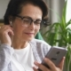 Senior Woman in Glasses Watching Videos - VideoHive Item for Sale