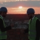 Two Worker From Construction Site Playing with Hands on the Rooftop of Building - VideoHive Item for Sale