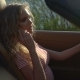 Young Pretty Blonde Woman Talking on Her Phone in Her Brand-new Car with Modern Inside and Leather - VideoHive Item for Sale