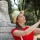 Woman Doing Selfie with Sphinx Statue on Mobile Phone in  in Villa Borghese on Sunny Day - VideoHive Item for Sale