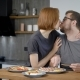 Husband and Wife Eat Breakfast Together. Behind the Wooden Bar, Behind the Modern Kitchen Interior - VideoHive Item for Sale