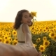 Dad and Daughter Walking Along the Field with Sunflowers at Sunset Holding Hands First-person View - VideoHive Item for Sale