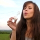 Woman Blowing Transparent Soap Bubbles Against the Blue Sky and Smill - VideoHive Item for Sale