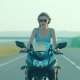 Girl Riding a Motorcycle in Sunglasses - VideoHive Item for Sale