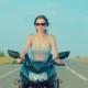 Young Girl with Brown Hair Rides a Motorcycle - VideoHive Item for Sale