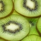 Slices of Kiwi Fruit Rotating on Turntable - VideoHive Item for Sale