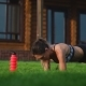 Fit Girl Doing Plank Exercise Outdoor in the Park Warm Summer Day. Concept of Endurance and - VideoHive Item for Sale