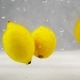 Lemons Are Falling and Swirling in the Water with Bubbles - VideoHive Item for Sale