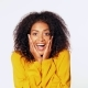 Beautiful African American Woman with Afro Hair in Yellow Wear Smiling, Pleasantly Surprised To - VideoHive Item for Sale