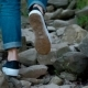 Legs of a Woman in Jeans and Crossover, Walking Alone on a Mountain Path with a Lot of Stones - VideoHive Item for Sale