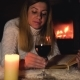 Woman Lies On A Blanket By The Fireplace Drinking Wine And Reading A Book - VideoHive Item for Sale