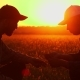 Soil, Two Farmers Exam Ground at Sunset - VideoHive Item for Sale