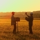 Two Farmers with a Shovel Walking on the Field. They Carry Equipment for Planting a Tree - VideoHive Item for Sale