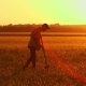 Farmer with a Shovel Walking on the Field. They Carry Equipment for Planting a Tree. On the Sunset - VideoHive Item for Sale