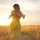 Girl Running Across Field in the Sunset - VideoHive Item for Sale