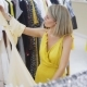 Woman Fitting the Yellow Dress in the Boutique. Fashionable and Stylish Girl Staying in Front of the - VideoHive Item for Sale