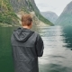 The Man Is Fishing on the Background of the Mountains in the Picturesque Fjord of Norway - VideoHive Item for Sale