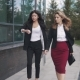 Business People Go Near the Office Center. Two Young Women in Business Suits - VideoHive Item for Sale