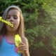 Happy Child Blowing Soap Bubbles in Park - VideoHive Item for Sale