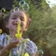 Happy Little Caucasian Girl Blowing Soap Bubbles in on a Sunny Day. Concept Happy Childhood - VideoHive Item for Sale